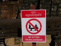 Inget sammanträde på balustrad-meddelande på Angkor Thom Arkivfoton