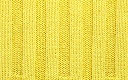 Ingiallisca la priorità bassa strutturata tessuto lavorata a maglia Immagini Stock