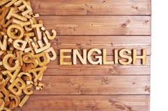 Inglés de la palabra hecho con las letras de madera Imagen de archivo libre de regalías