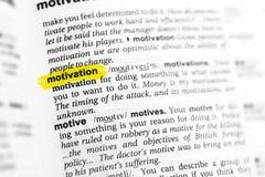 ` Inglés destacado de la motivación del ` de la palabra y su definición en el diccionario Imagen de archivo libre de regalías