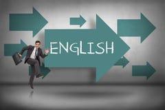 Inglês contra apontar azul das setas imagem de stock