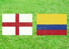 Inglaterra contra o fundo dos esportes de Colômbia fotos de stock royalty free