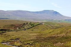 Ingleborough and Blea Moor from Whernside. Looking south from the eastern slope of Whernside in North Yorkshire, England to Ingleborough (mountain) in th Royalty Free Stock Photography