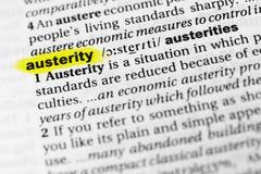 ` Inglese evidenziato di austerità del ` di parola e la sua definizione nel dizionario immagini stock