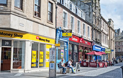 Inglis Street, Inverness. Inglis Street Inverness with Money Shop,  Costa Coffee and Carphone Warehouse typical of many British cities visible Royalty Free Stock Image