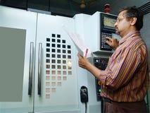 Ingénieur sur la machine Photo stock
