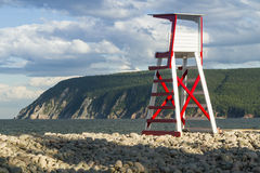 Ingonish Beach Lifeguard Chair. A lifeguard chair on rocky Ingonish Beach, with Cape Smokey in the background in the Cape Breton Highlands, Nova Scotia royalty free stock photo