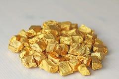 Ingots lub bryłki Czysty złoto Złocisty liść Herbaciany żywica Puer Fotografia Royalty Free