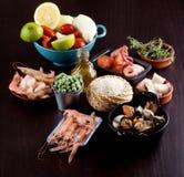 Ingrédients crus pour la Paella Image stock