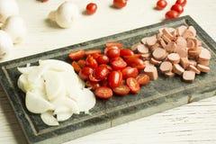 Ingrédients pour la pizza italienne image stock