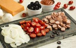 Ingrédients pour la pizza italienne image libre de droits