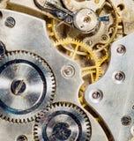 Ingranaggi d'annata antichi d'argento del corpo dell'orologio da tasca dell'oro Fotografia Stock