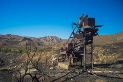 Ingranaggi della miniera di Delapidated Fotografia Stock