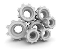 Ingranaggi e ruote dentate del metallo su fondo bianco Immagini Stock