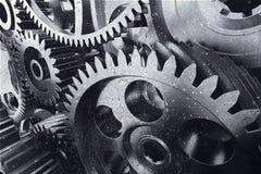 Ingranaggi industriali del metallo in un primo piano fotografia stock