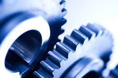 Ingranaggi, meccanismo industriale, concetto di tecnica fotografia stock libera da diritti