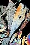 Ingrandimento Hundredfold dell'acido citrico dei cristalli fotografia stock