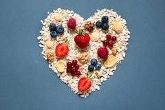 Ingrediënten voor het koken van gezond ontbijt in vorm van hart Royalty-vrije Stock Fotografie