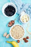 Ingrediants for breakfast. Ingredients for helthy breakfast, raw oat flakes with banana and nuts stock images