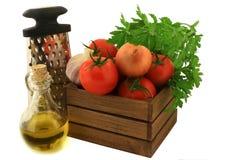 Ingredienser för att laga mat tomater öser Arkivbild