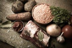Ingredienser för Turkiet grönsaksoppa med röda linser som ligger på Royaltyfri Bild