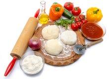 Ingredienser som gör en pizza Arkivbild