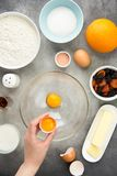 Ingredient for cooking easter cakes with icing, orange, dried fruits, spring holiday. Flour, milk, sugar, raisins, dried apricots. Egg yolks stock photos