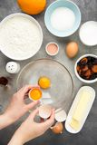 Ingredient for cooking easter cakes with icing, orange, dried fruits, spring holiday. Flour, milk, sugar, raisins, dried apricots. Egg yolks stock photo