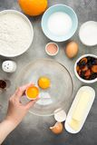Ingredient for cooking easter cakes with icing, orange, dried fruits, spring holiday. Flour, milk, sugar, raisins, dried apricots. Egg yolks royalty free stock image