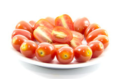 Ingredient fresh tomato sliced on white plate Stock Photography
