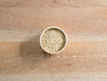 Ingredient grain, wheat germ in wooden bowl on wooden background Royalty Free Stock Photo