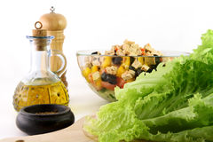Ingredient for greek salad. In the bowl, oil, green salad and spice Royalty Free Stock Image