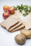 Ingredient. Healthy raw ingredients such as rice, bread, apple, potato, parsley Stock Image