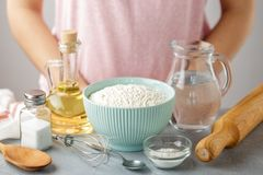 Ingredients for making homemade tortillas on the kitchen table: flour, water, oil, salt, baking powder. royalty free stock photography