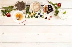 Ingredient for preparing healthy breakfast: chia, muesli, frozen royalty free stock images