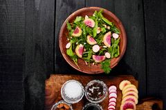 Ingredient and salad brown plate. Mix leaf, Radish, Lettuce, mangold, parsley, dill, arugula, almond, salt, tasty, balsamic pepper Healthy diet Clear food Stock Photography