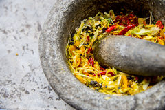 Ingredient of Thai curry are in the mortar during pound Royalty Free Stock Images