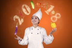 Ingredientes de alimento de mnanipulação do cozinheiro chefe do mágico Foto de Stock
