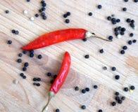 Ingredientes de la especia caliente para la comida Todavía la vida con las semillas de la paprika de la pimienta de chiles roja y Fotos de archivo libres de regalías