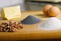 Ingredientes de la torta de la amapola Foto de archivo libre de regalías