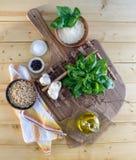 Ingredientes del Pesto en la madera Foto de archivo libre de regalías