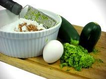 Ingredientes naturales de los molletes del calabacín de la hornada Fotos de archivo libres de regalías