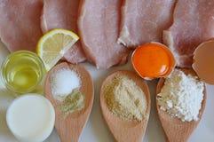 Ingredientes para el escalope del cerdo Fotografía de archivo libre de regalías