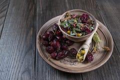 Ingredienti della tisana sulla tavola di legno Fotografie Stock Libere da Diritti