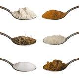 Ingredienti di alimento in cucchiai isolati Immagine Stock Libera da Diritti