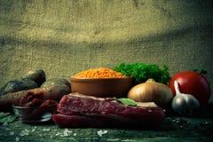Ingredienti per la minestra di verdura della Turchia con le lenticchie rosse, trovantesi sopra Immagine Stock Libera da Diritti