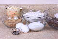 Ingredients. All the ingredients to make chocolate chip cookies in bowls stock photography