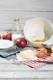 Ingredients for apple pie, apples, butter, eggs, flour, milk and sugar Stock Photography