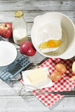 Ingredients for apple pie, apples, butter, eggs, flour, milk and sugar Royalty Free Stock Image