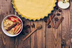 Ingredients for apple tart, apples and cinnamon on rustic wooden background. Ingredients for apple tart, apples and cinnamon on the rustic wooden background Royalty Free Stock Photos